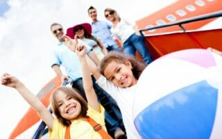 bigstock-Happy-kids-traveling-by-airplane-1024