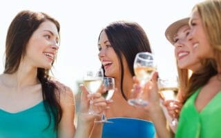 summer holidays, vacation and celebration - girls with champagne