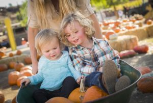 Adorable Young Family Enjoys a Day at the Pumpkin Patch.