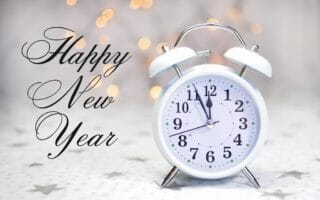 Happy New Year Message With White Retro Clock Showing Five To Mi